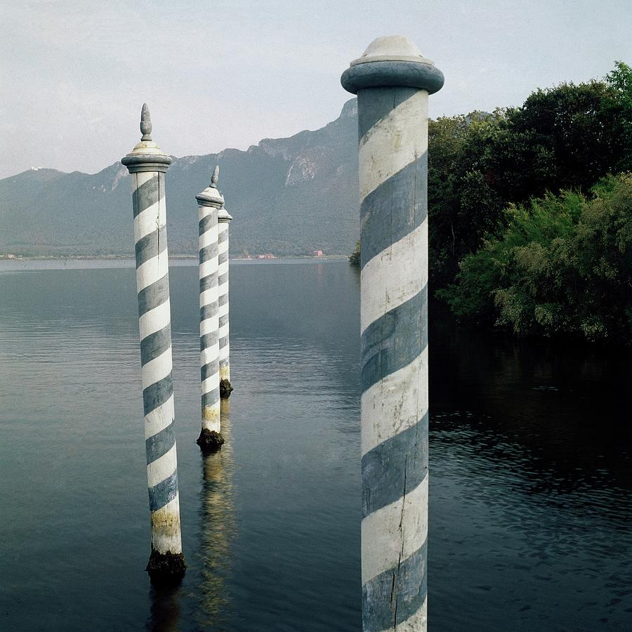 Striped Posts In The Grand Canal Photograph by Leombruno-Bodi