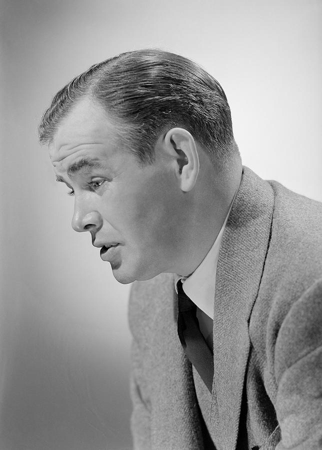 Studio shot of mid adult man Photograph by George Marks