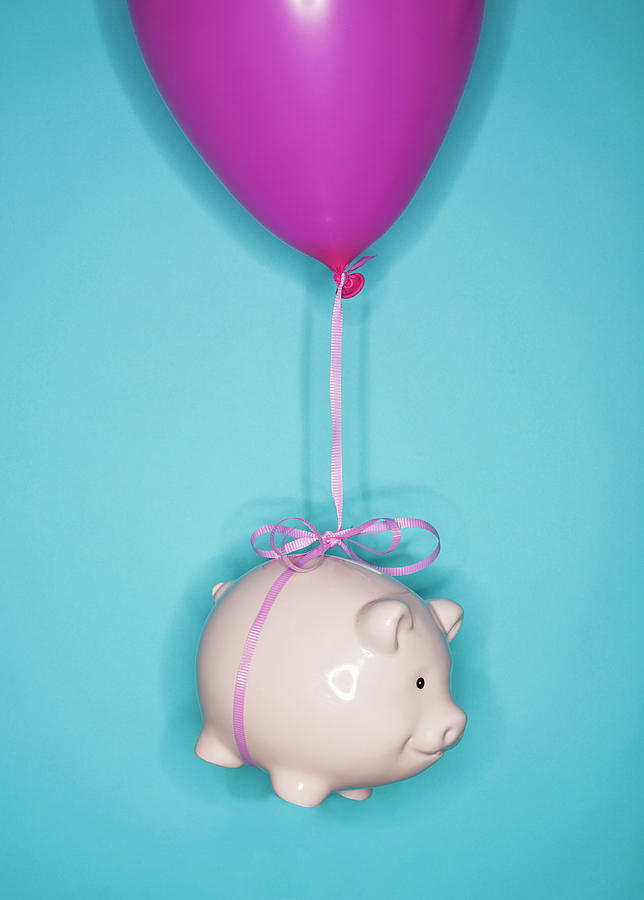 Studio Shot Of Piggy Bank Lifted By Photograph by Tetra Images