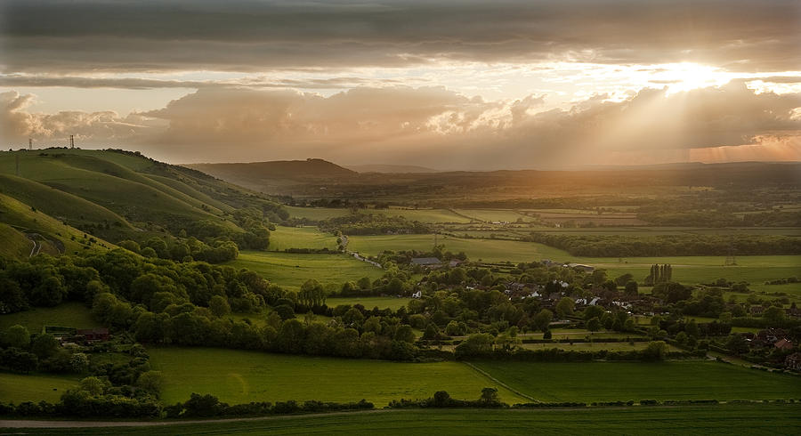 Stunning countryside landscape with sun lighting side of hills a Photograph  by Matthew Gibson