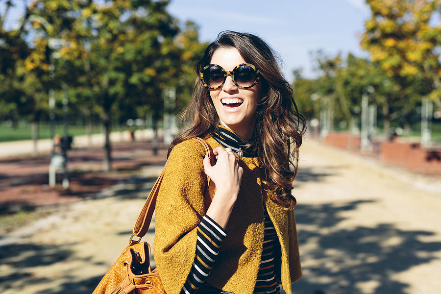 Stylish woman at the park on a sunny autumn day Photograph by Westend61