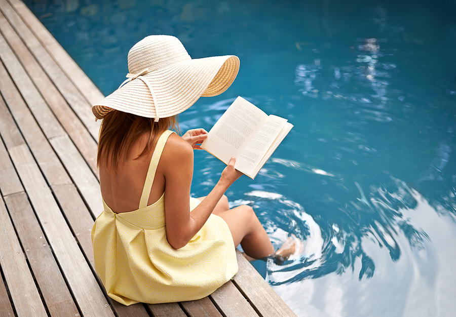 Summer vacation with a great book Photograph by PeopleImages