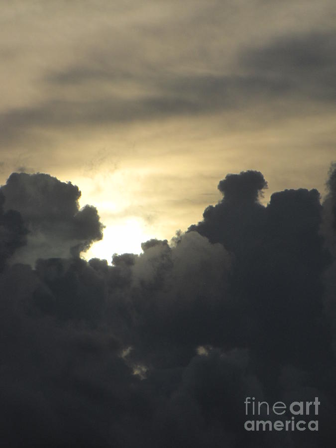 Storm Clouds Photograph - Sun Behind The Storm by Gayle Melges