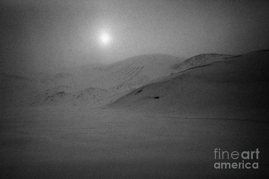 Whalers Photograph - sun breaking through white out snowstorm whalers bay deception island Antarctica by Joe Fox
