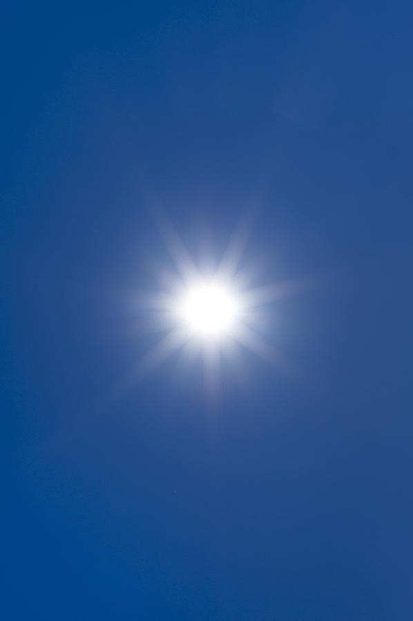 Sun Photograph - Sun In A Blue Sky by Science Photo Library