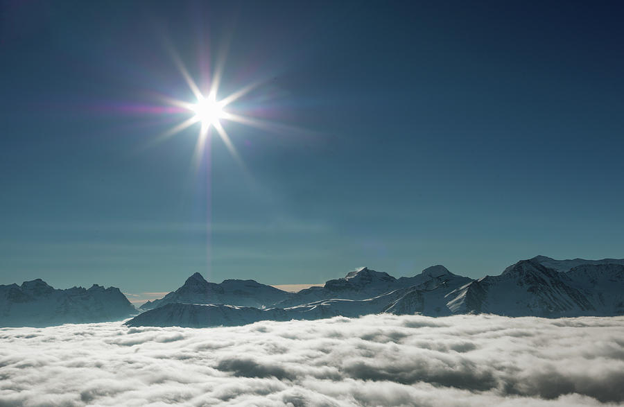 Sun Over Fog In The Swiss Alps Photograph by Buena Vista Images