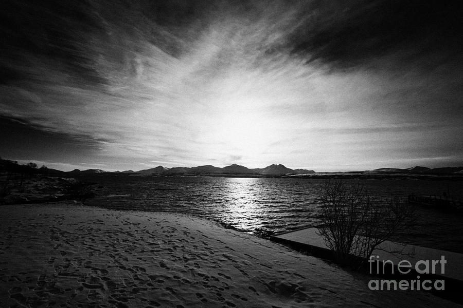 Telegrafbukta Photograph - sun setting with halo over snow covered telegrafbukta beach Tromso troms Norway europe by Joe Fox