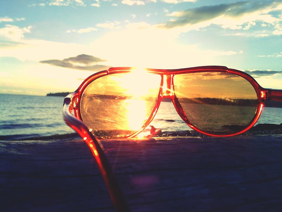 Sunglasses On Beach During Sunset Photograph by Ashley Stone / Eyeem