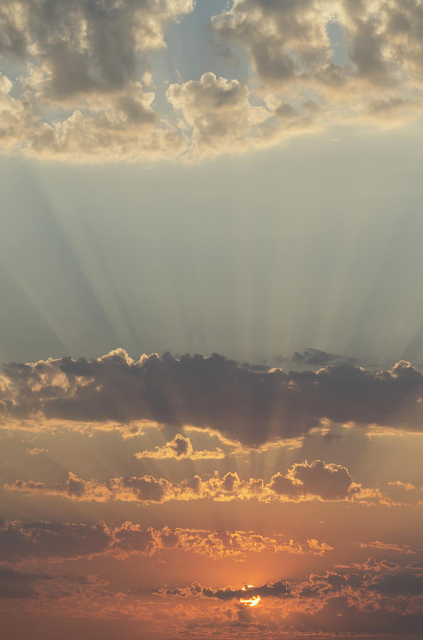 Cloud Photograph - Sunlight Shining Through Clouds And by Keith Levit