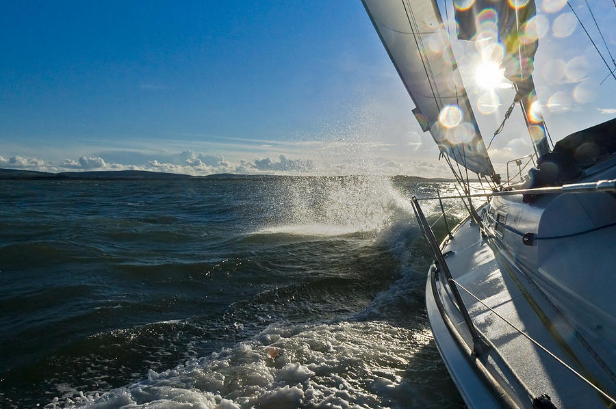 Sailing Photograph - Sunlit Bow Spray by Gary Eason