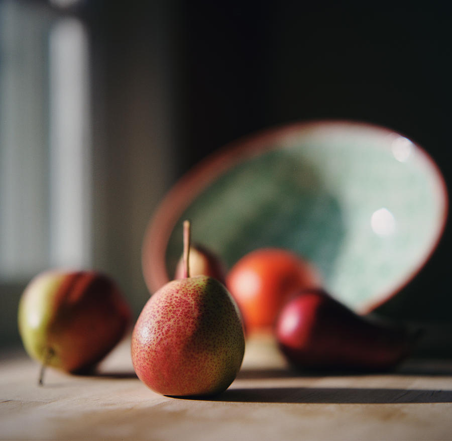 Sunlit Pears On Kitchen Counter Photograph by Danielle D. Hughson
