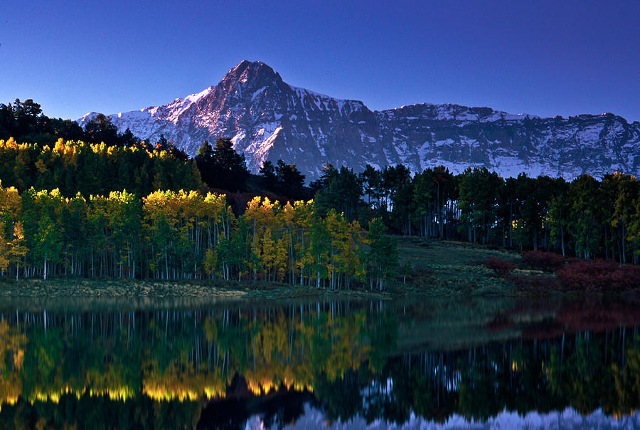 Mountains Photograph - Sunny morning reflection by Mike  Bennett