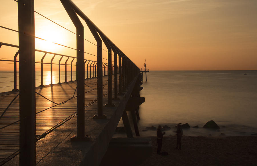 Sunrise On The Pier Of Badalona Photograph