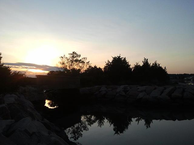 Sunset Photograph - Sunset And Fishing by Anastasia Konn