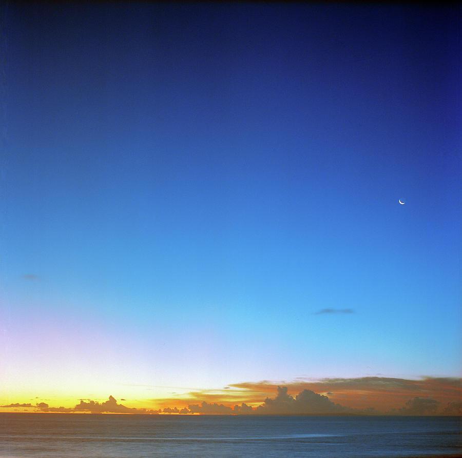 Sunset And Moon At Uluwatu Photograph by Vsevolod Vlasenko