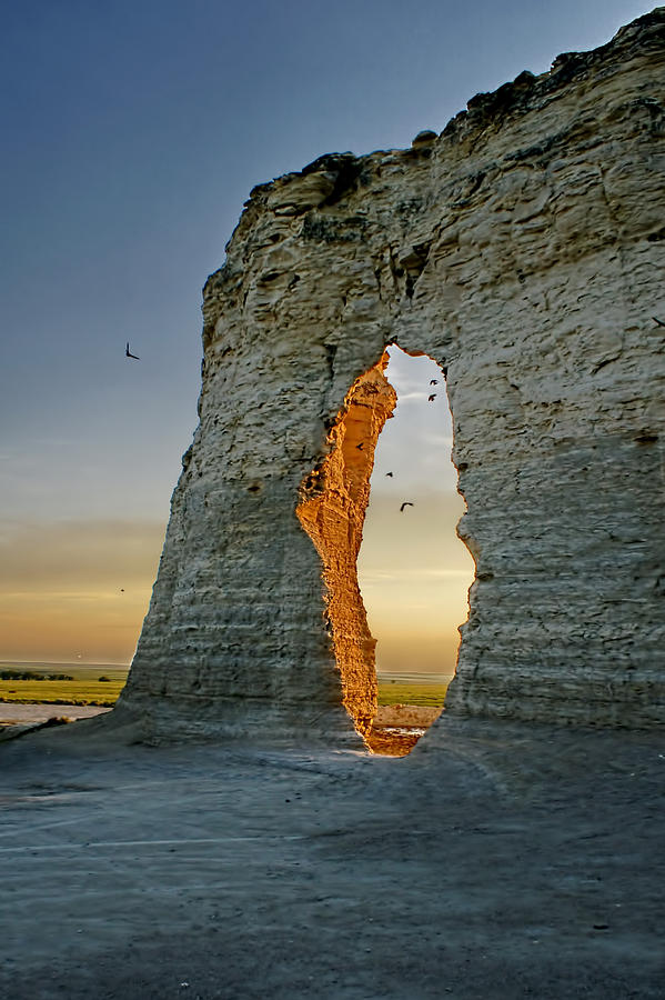 Monument Rocks Photograph - Sunset Through The Keyhole by Alan Hutchins