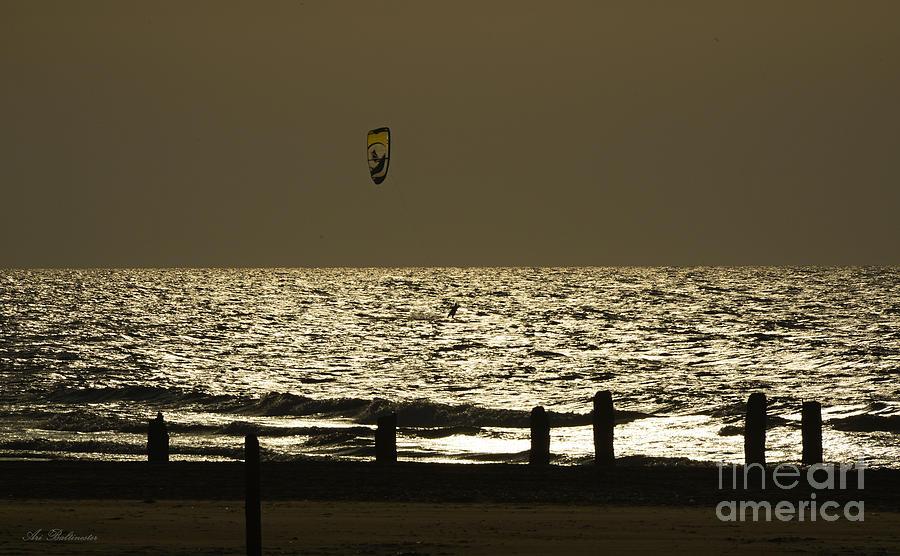 Surfing Photograph - Surfing At Sunset by Arik Baltinester