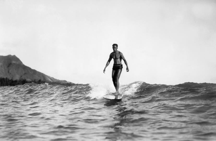 1929 Photograph - Surfing At Waikiki Beach by Underwood Archives