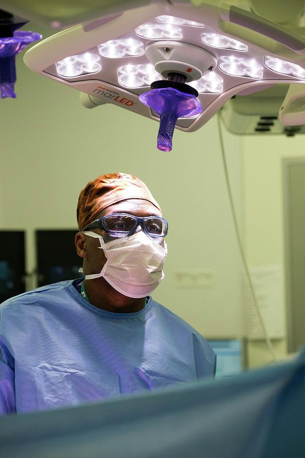 Overhead Light Photograph - Surgeon Performing An Operation by Mark Thomas/science Photo Library