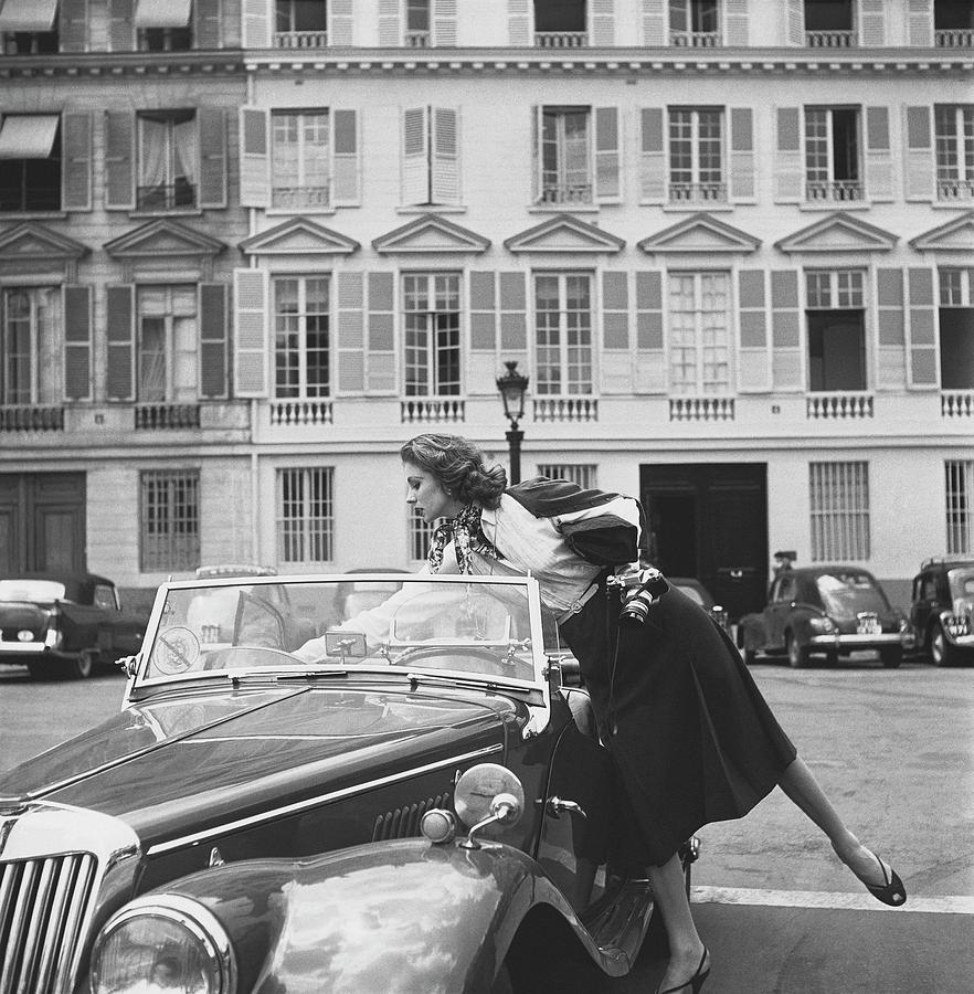 Suzy Parker Outside The French Vogue Office Photograph by Jacques Boucher