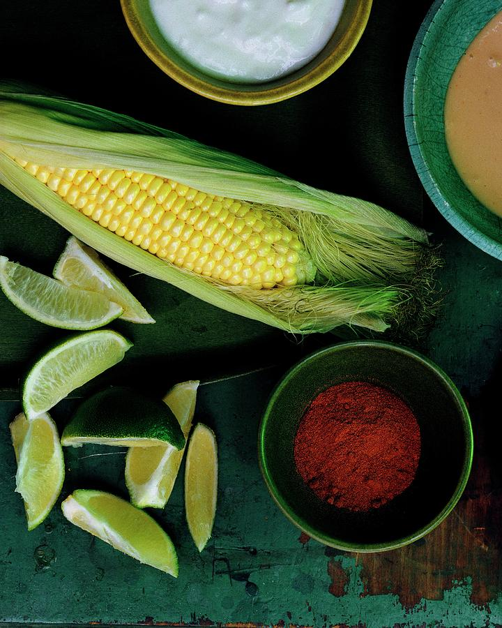 Sweetcorn And Limes Photograph by Romulo Yanes