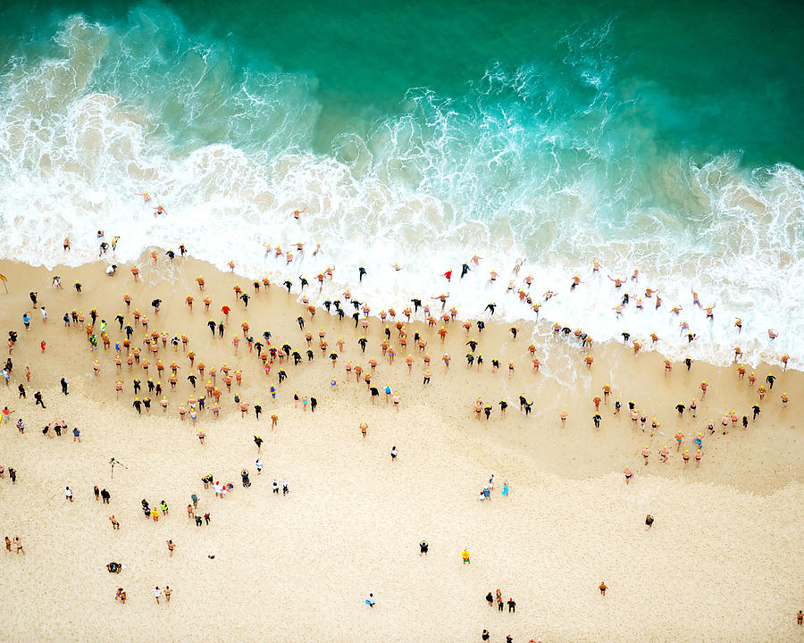 Swimmers Entering The Ocean Photograph by Tommy Clarke