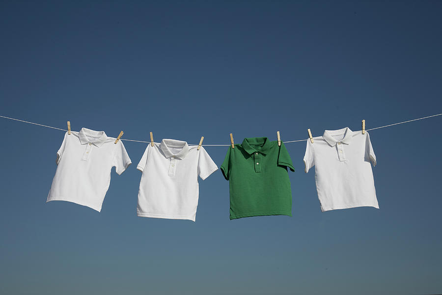 T-shirts On A Washing Line Against A by Paul Burley Photography