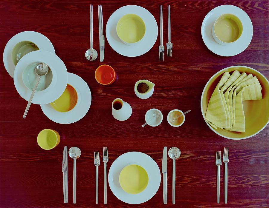 Tableware Set On A Wooden Table Photograph by Romulo Yanes