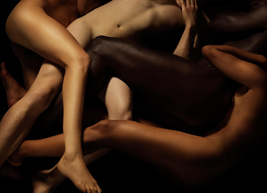Tangled Human Bodies Of Different Skin Photograph by Jonathan Knowles