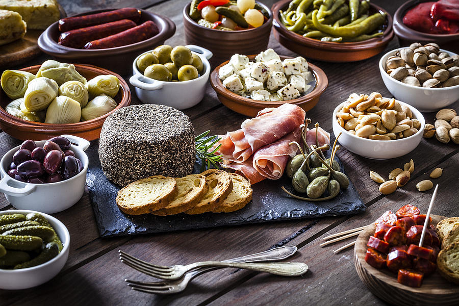 Tapas On Rustic Wooden Table Photograph by Fcafotodigital