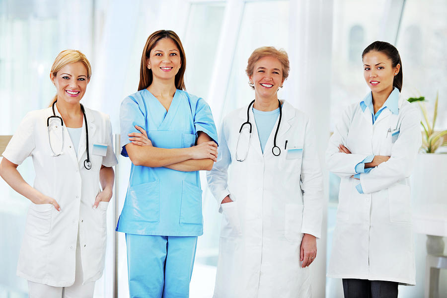 Team Of Female Doctors Photograph by Skynesher