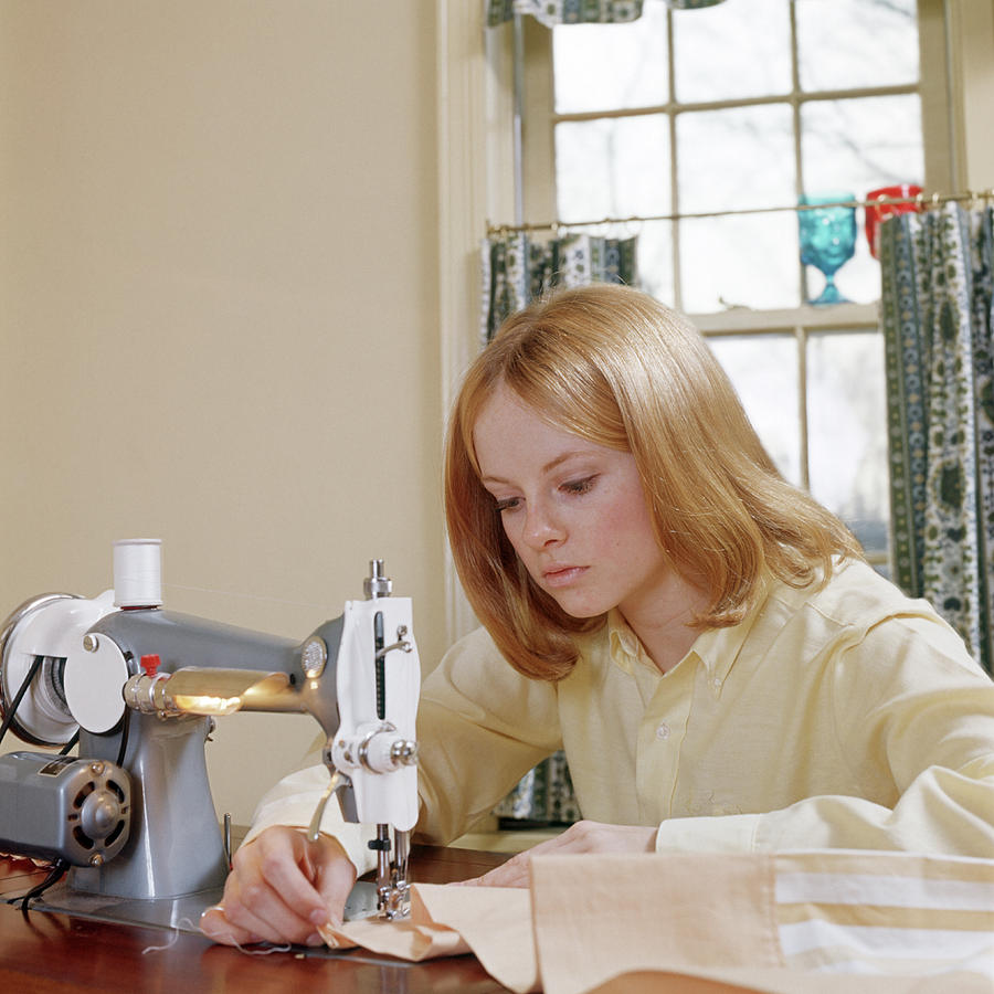 Teen Girl Using Sewing Machine by Vintage Images