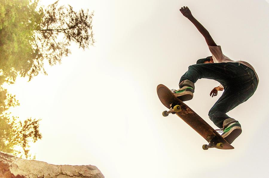 Teenage Boy Performing Stunt On Photograph by @ Mariano Sayno / Husayno.com