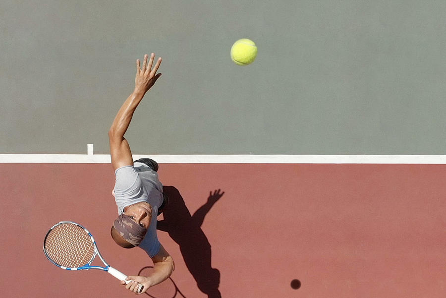 Tennis Player Serving Photograph by Tunart