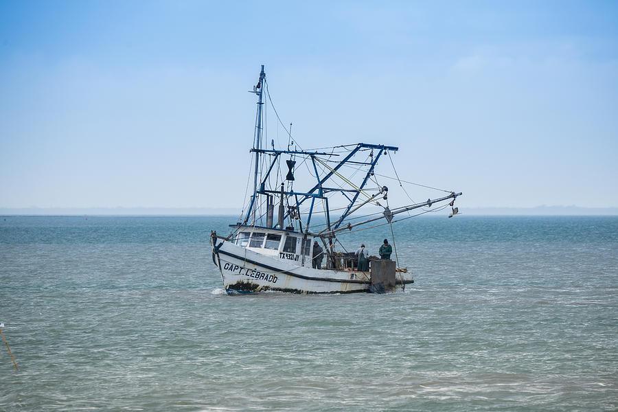 Texas Oyster Boat Captain Lebrado Photograph By Jg Thompson