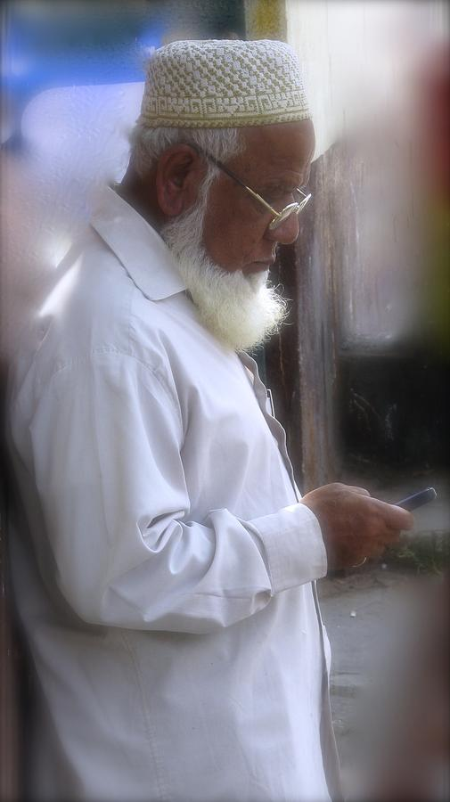 India Photograph - Texting On The Corner by Russell Smidt