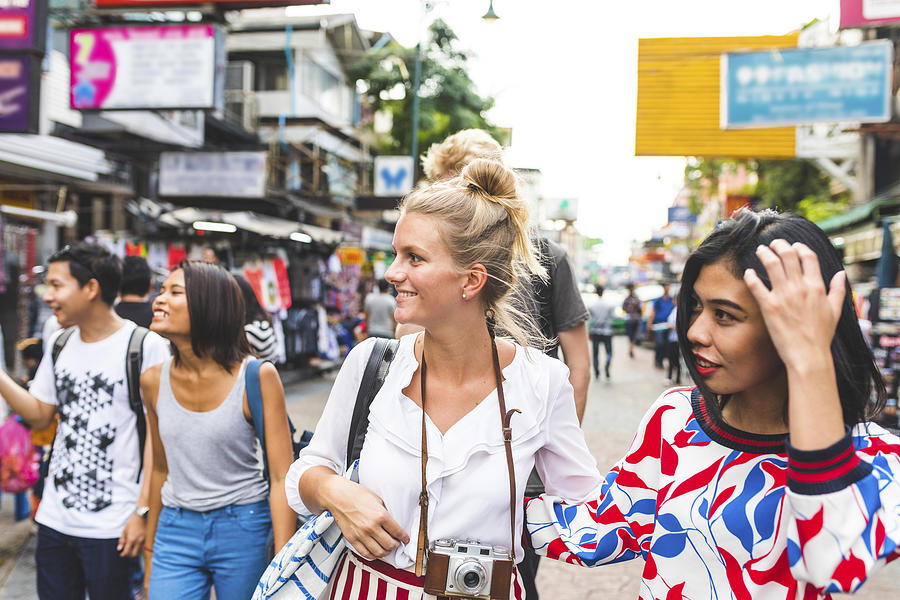 Thailand, Bangkok, Khao San Road, group of friends exploring the city Photograph by Westend61