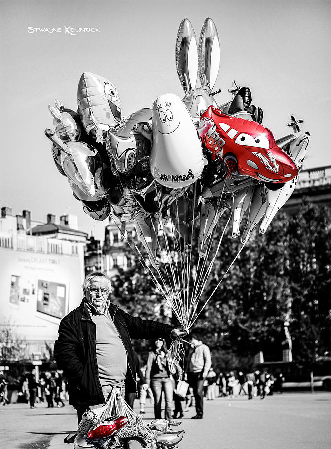 Fine Art America Photograph - The balloon salesman by Stwayne Keubrick