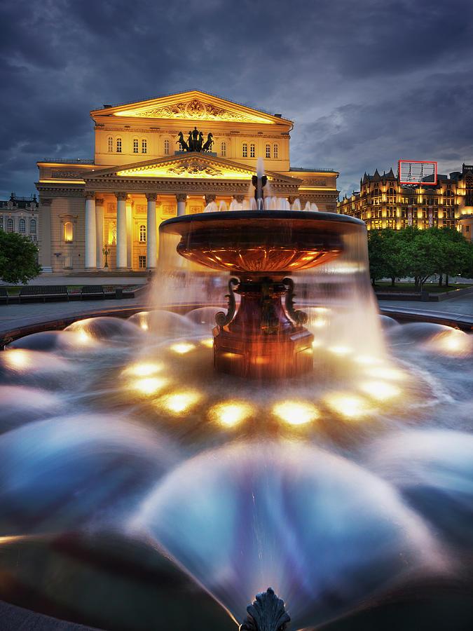 The Bolshoi Theatre And Fountain At Dusk Photograph by Jon Hicks