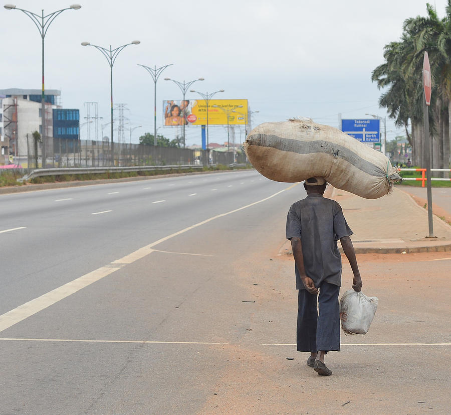 Accra Photograph - The Burdens We Carry by Ronda Broatch