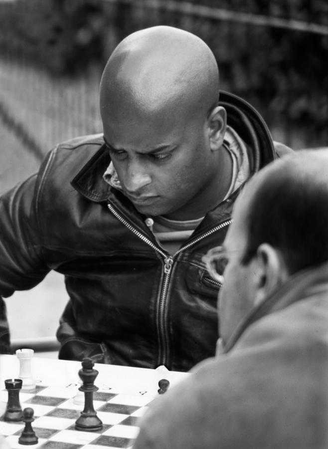 Black And White Photograph - The Chess Player by Bernard  Barcos