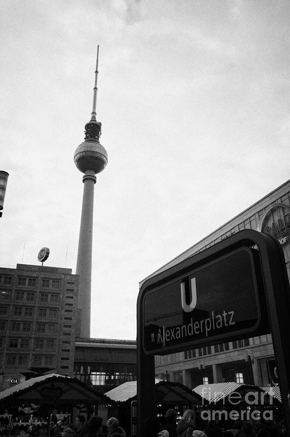 Berlin Photograph - the christmas market in Alexanderplatz with the Berlin Fernsehturm and U-bahn sign Germany by Joe Fox