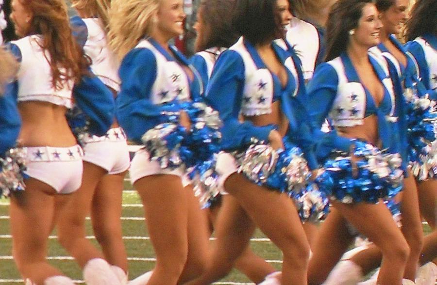 The Dallas Cowboys Cheerleaders Photograph - The Dallas Cowboys Cheerleaders by Donna Wilson