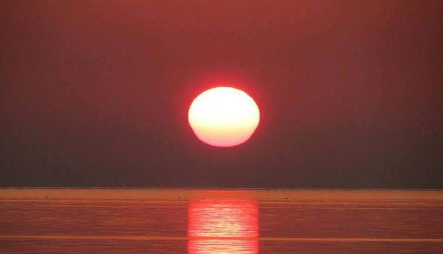 The Distant Sun Photograph by Jeff Pattison
