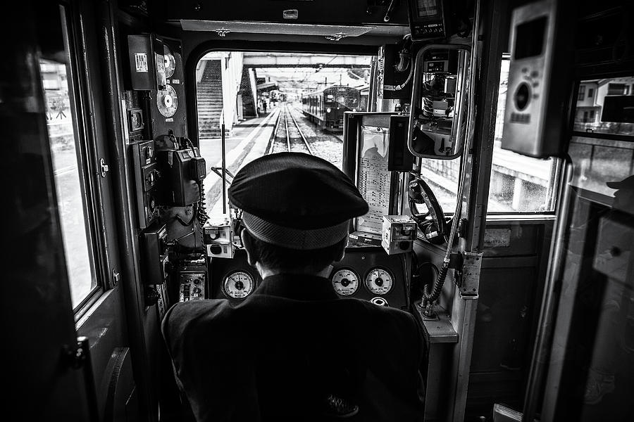 Transportation Photograph - The Driver by Marco Tagliarino