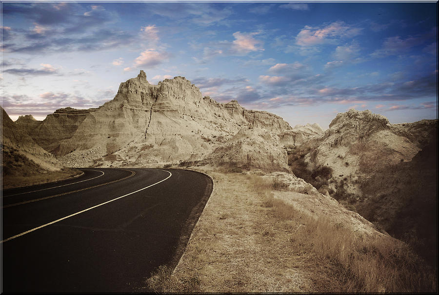 Landscape Photograph - The Edge Of The Badlands by Jens Larsen