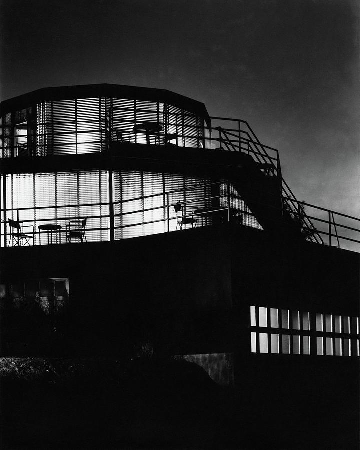 The Exterior Of A Spiral House Design At Night Photograph by Eugene Hutchinson