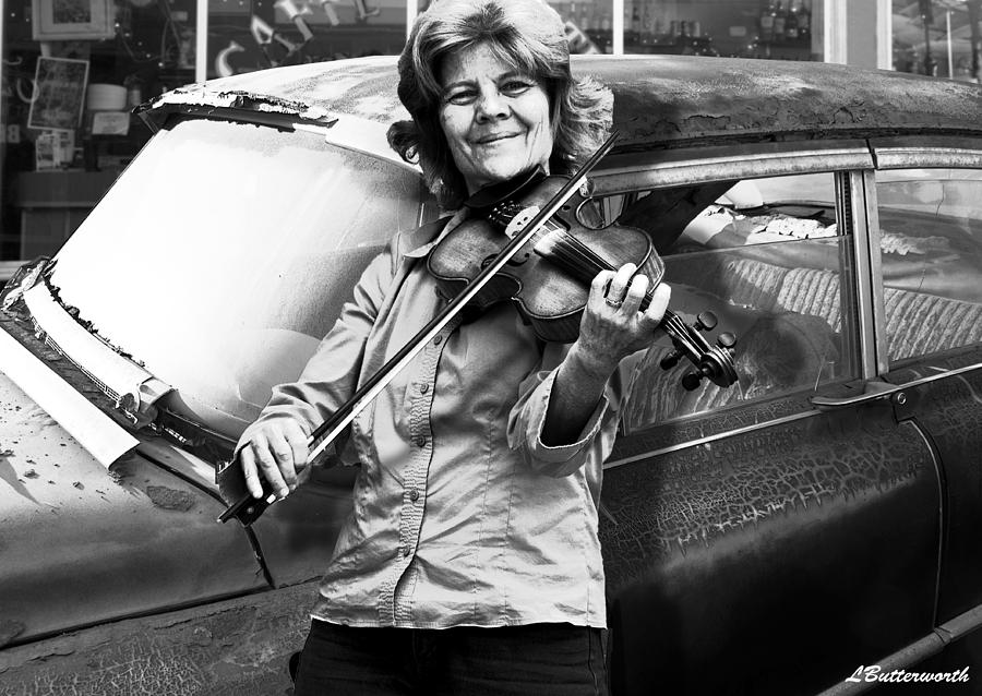Fiddle Photograph - The Fiddle Player by Larry Butterworth