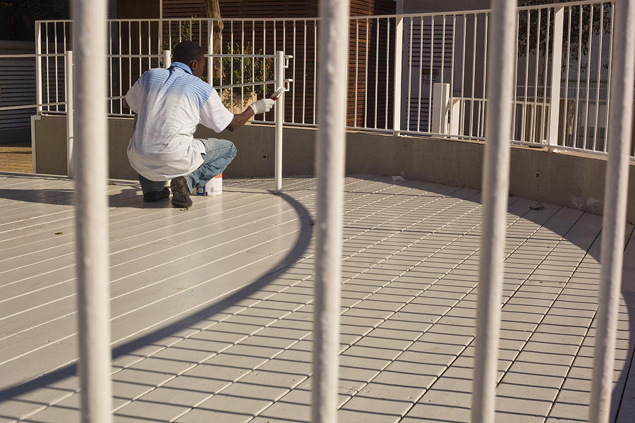 Social Photograph - black man painting white fence - The Fine Line by Kobi Amiel