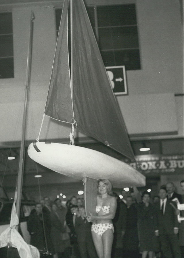 Retro Photograph - The Girl With A Boat On Her Shoulder. It Weigh Only 40 Les by Retro Images Archive